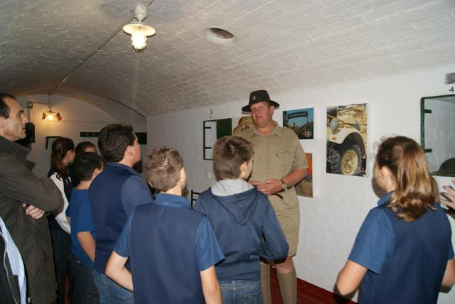 Zetef du Plessis in the Heritage Group Bunker; addressing the group of visitors